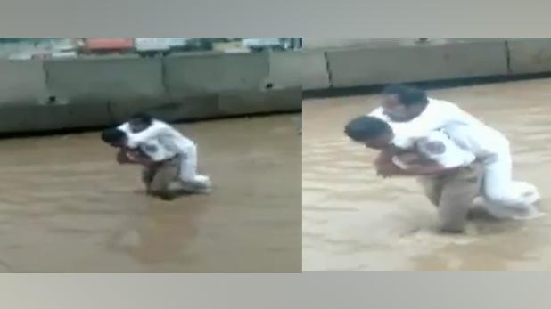traffic police inspector Nagamallu, VIDEO: ऐसे भी होते हैं पुलिसवाले, बुजुर्ग के पैर में था प्लास्टर तो कंधे पर उठाकर पानी से निकाला